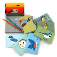 colorful canvas mini wallets with bird graphics